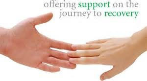 "Two hands touching with the words ""Offering support on the journey to recovery"""