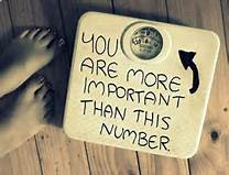 "A weight scale with the words ""You are more important than this number"""