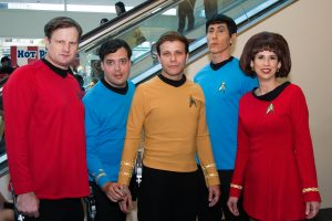 Trekkers dressing up in authentic star trek costumes as seen on the show at a star trek convention