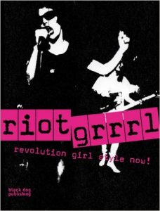 A picture of the book Riot Grrrl: Revolution Girl Style Now! by Nadine Modem. A black and white picture of  women singing with sun glasses on with the title of the book in black and pink