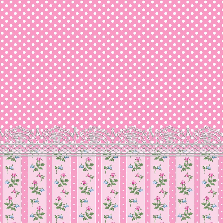 Pink Background with white polka dots and lace/flower bottom edge.