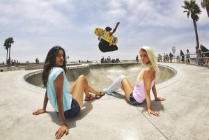 Women watching a man skate