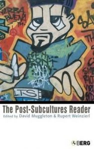 "Cover of the book ""The Post Subculture Reader"" featuring an image of street Graffiti that depicts a cartoon style man smoking a cigarette and covered in graffiti writing."