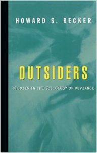 Blue cover with bolded title OUTSIDERS