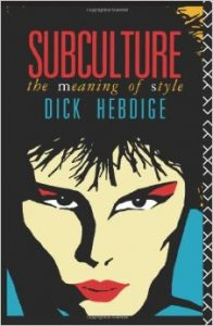 Book cover of Subculture The Meaning of Style by Dick Hebdige. Cartoonlike drawn face of person with red lipstick and red eyeshadow, piercing their lips.