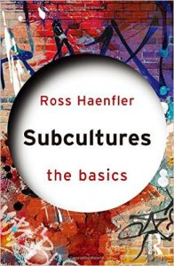 Book cover of Subcultures The Basics by Haenfler. Colorful background with white circle on front page, bolded lettering of title Subcultures The Basics by Ross Haenfler.