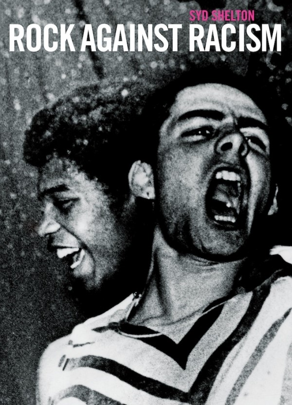 A black and white poster for the Rock Against Racism concert featuring a black man and a white man. The white man yells in the foreground while the black man laughs amused from behind