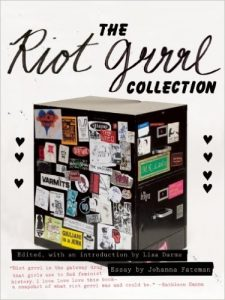 "An image of the cover of ""The Riot Grrrl Collection"" featuring a filing cabinet covered with Riot Grrrl images and text."