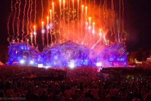 Tomorrowland Festival 2014 mainstage. Panoramic image of the stage lit up and fireworks shooting out from the top.