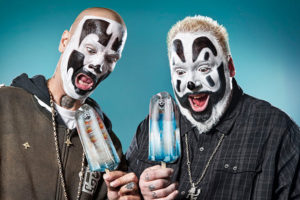 The two main singers of Insane Clown Posse in their black and white clown makeup with surprised facial expressions. Shaggy 2 Dope (left) and Violent J (right).