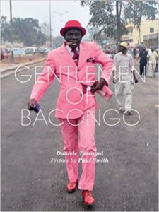 Book title with a Sapeur on the cover striding towards the camera with a cigar in his mouth.