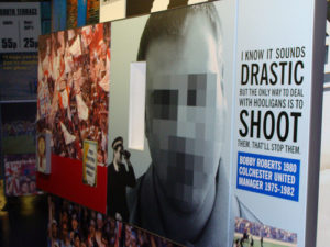 A billboard with a quote from a former coach who believes the only way to end hooliganism is to shoot and kill them all