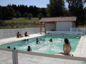 Nudists swimming in the pool.