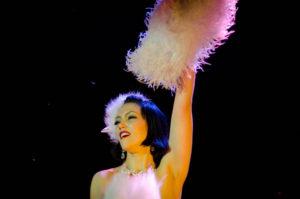 Performer holding fan, waving