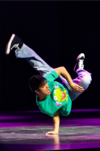 Close up photo of a B-boy performing a pike