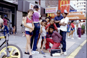 Image of eight B-boy kids posing 96th Street in New York City in the 1980s
