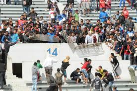 A group of Moroccan hooligans fight and destroy a barrier in the stands
