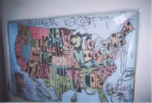 This is an image of a map in a living room an AJJ show was held in. It shows satirical or crude writing for all the states. For example where North Carolina is it just says incest.