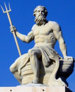 Sculpture of Poseidon sitting on a rock/platform