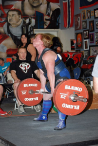 Powerlifter deadlifting a large barbell