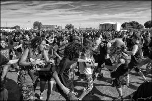 A picture of a group of young men in a mosh pit.