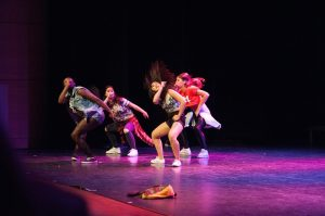 Image of a four person B-girl crew performing on stage