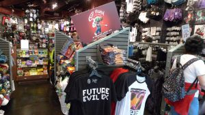 An image of the interior of a Hot Topic retail store with various clothing that commodify various subcultures.