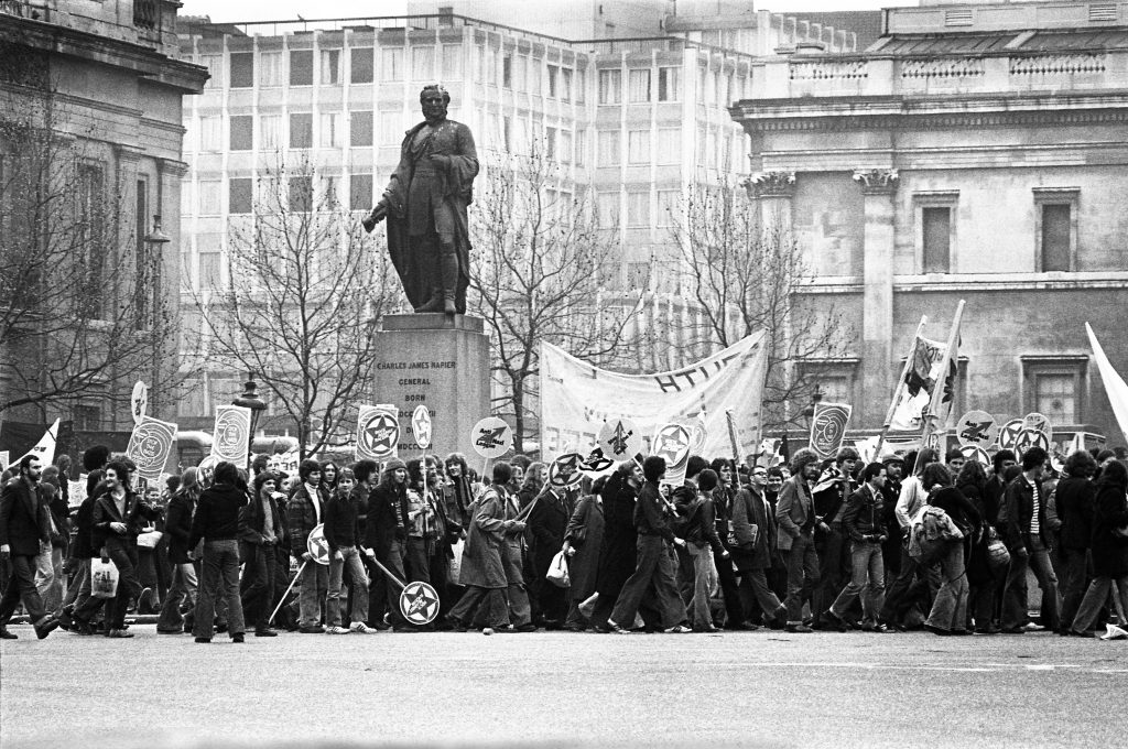 Black and white photo of the Rock Against Racism March in Victoria Park, London