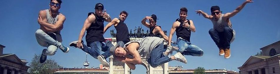 image of seven bboys jumping while dancing