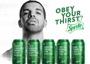 "Drake is pictured in a Sprite ad with the slogan ""Obey your thirst?"" He is seen here next to cans of Sprite that are marketed with his (very profitable) lyrics including ""Started from the bottom"" and ""Know yourself, know your worth""."