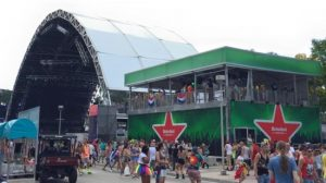 Green Heineken beer pavilion next to a stage at Ultra Music Festival