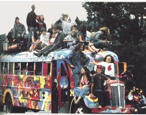 Colored picture of hippies lounging on a decorated bus