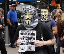 """Anonymous protestor with a sign saying """"the corrupt fear us. The honest support us. The heroic join up"""""""