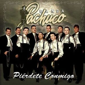 "The band ""Banda Pachuco"" is pictured on an album cover. They are all matching, wearing black zoot suits with white dress shirts and silver ties."