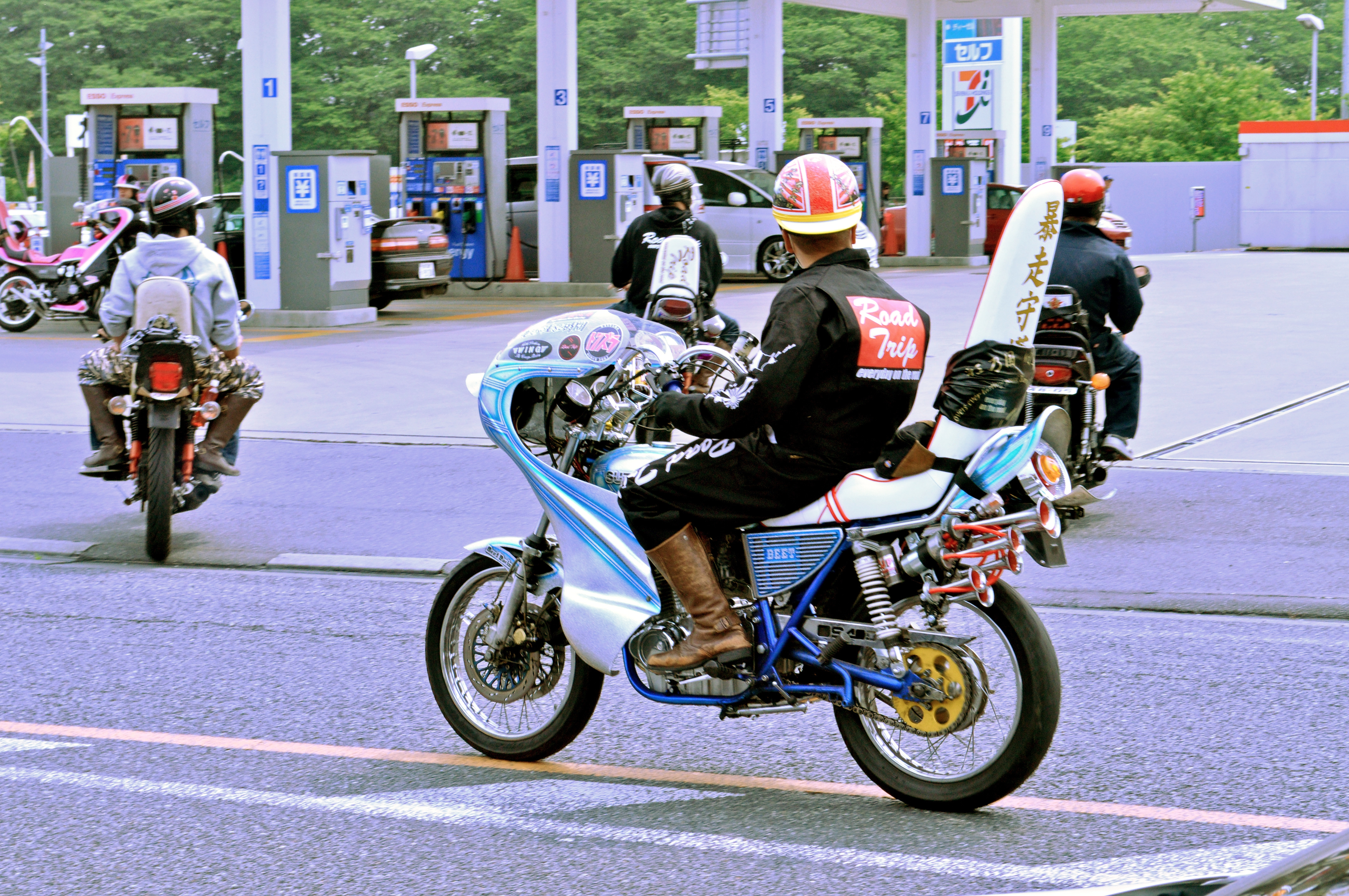 Five or more bōsōzoku members on their modified motorcycles stopped at a 7/11 convenience store somewhere in Japan.