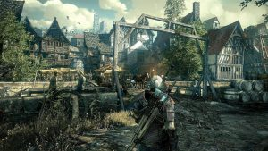 Main character of Witcher 3 entering a medieval looking town