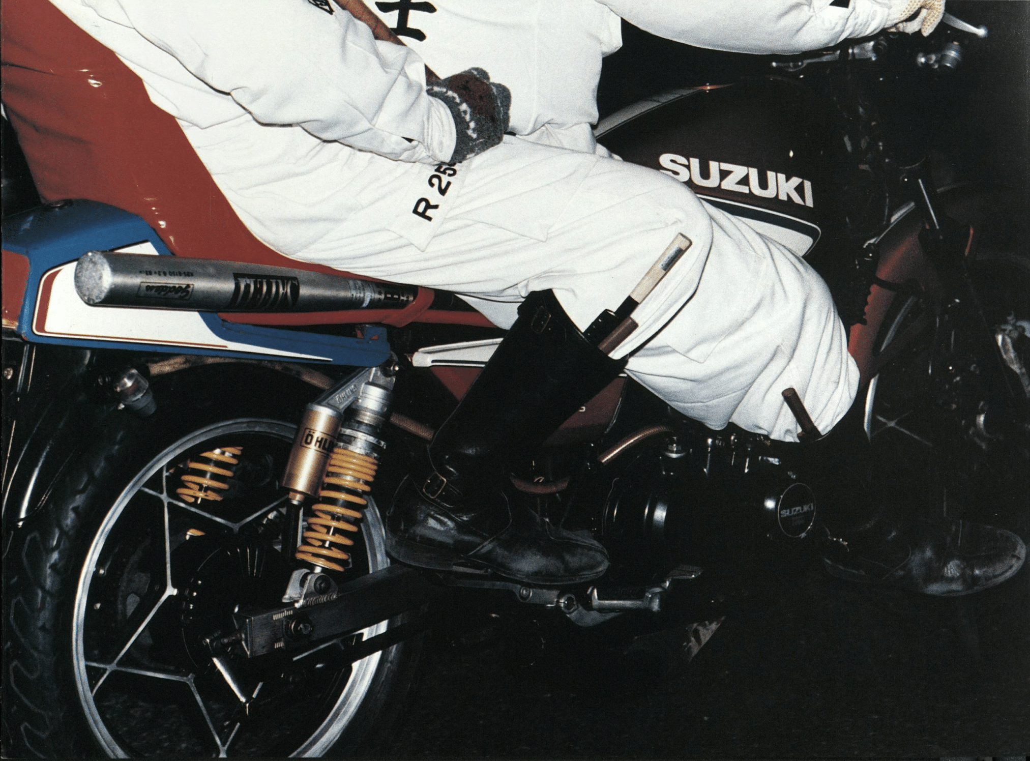 Close up of knives hidden in the boots of two bōsōzoku members with a baseball bat strapped onto their motorcycle.