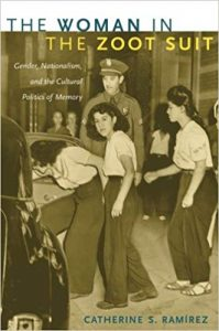 The cover to Catherine Ramirez's book shows three women in baggy clothing being escorted into a police car by a police officer.