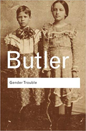 The cover of the book Gender Trouble by Judith Butler. It shows an old-fashioned black & white photograph of two children wearing dresses.