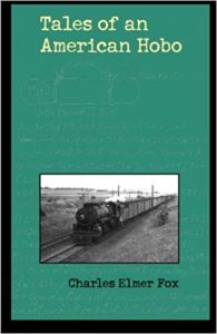 """A green book cover with a black and white picture of a freight train at the bottom. Text reads, """"Tales of an American Hobo. Charles Elmer Fox"""""""