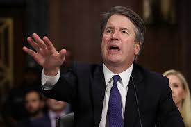 Supreme Court Justice Brett Kavanaugh gestures with an extended hand while speaking at his confirmation hearing.
