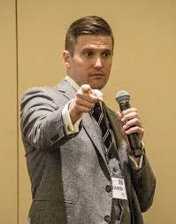 White Nationalist and leading Alt-Right figure Richard Spencer points to the crowd while addressing an audience during a speech.