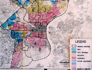 Shows a city broken up into various colors each coded to denote desirability as determined by the racial composition of the area.