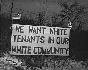"""A billboard-esq sign reads """"We want white tenants in our white community"""""""